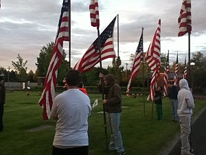 posting flags for Memorial Day in Richland, WA