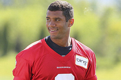 Quarterback Russell Wilson #3 of the Seattle Seahawks smiles as he leaves the field after minicamp at the Virginia Mason Athletic Center on May 11, 2012 in Renton, Washington.
