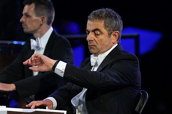 British actor Rowan Atkinson in his role as Mr Bean takes part in the Opening Ceremony of the London 2012 Olympic Games at the Olympic Stadium on July 27, 2012 in London, England.