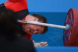 Matthias Steiner of Germany lies on the floor after failing to lift in the Men's +105kg Weightlifting final on Day 11 of the London 2012 Olympic Games