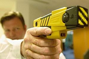 A policeman holds the new advanced taser gun.