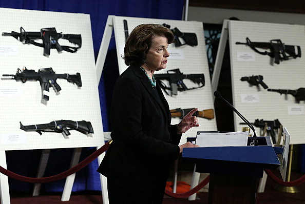 U.S. Senator Dianne Feinstein (D-CA) speaks next to a display of assault weapons during a news conference January 24, 2013 on Capitol Hill in Washington, DC.