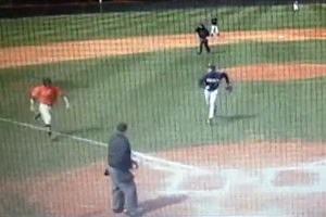 College Baseball Pitcher Tackles Runner