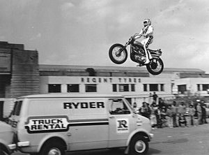 23rd May 1975: American stuntman Evel Knievel practicing jumping over three vans in the car park of Wembley Stadium.