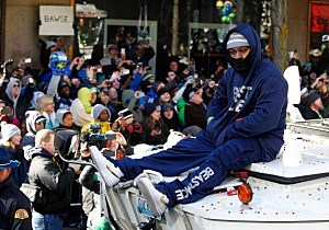 Marshawn Lynch #24 of Seattle Seahawks celebrates with fans during a parade to celebrate their  victory in Super Bowl XLVII