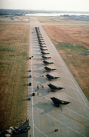F-117A Stealth fighter aircraft line the runway